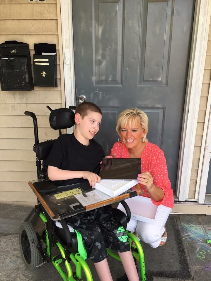 Debra Shipley Roffo with Jeremy, who has cerebral palsy and communicates with an iPad. When his iPad broke, his mother wondered how she would get the money to fix it. Roffo's 'angels' stepped into action and raised enough money to buy him a brand new one.