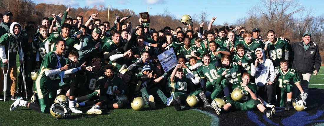 The Hendricken freshman football team takes a group photo after edging Barrington, 7-6, for the state title at Johnston High School on Sunday.