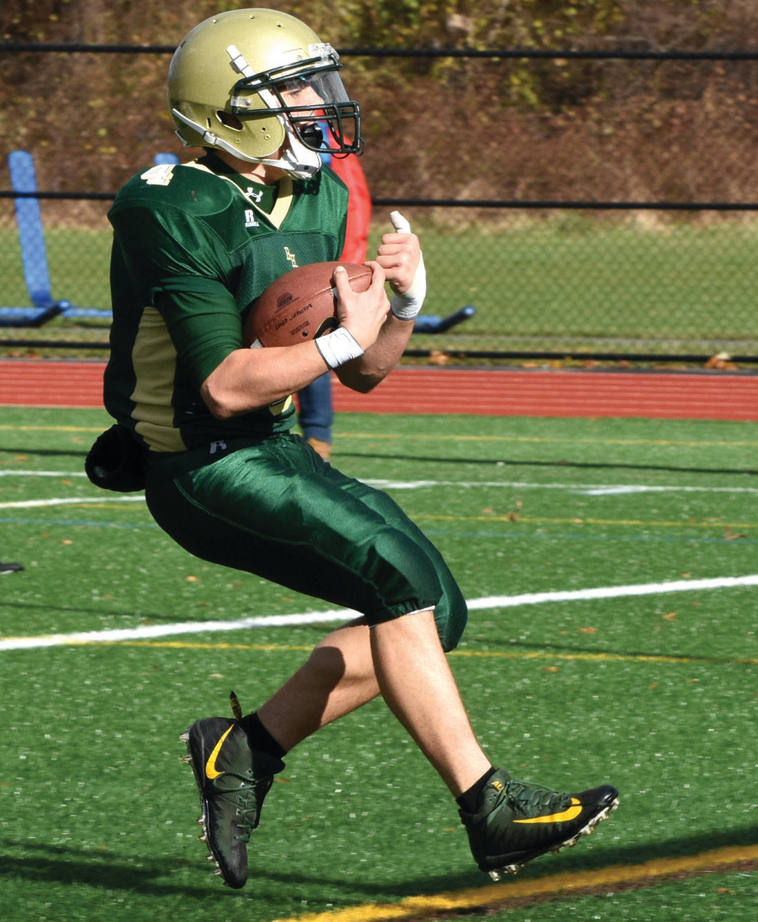 Zach Lavergne finds the end zone on a 14-yard run for the lone Hendricken touchdown in the game.