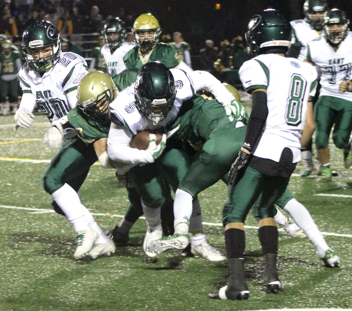 Rayven DeOliveira rushed for two touchdowns against Hendricken.
