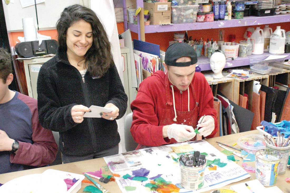 HAPPY WORKER: Art teacher Vanessa Rundlett helps out artist Andrew in a morning art class at the Artist's Exchange.