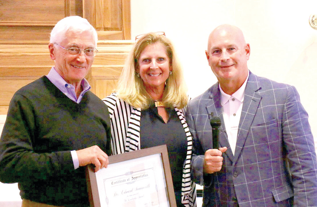 FIGHTERS OF DEMENTIA: Bill (right) and Katharine White recently give a certificate of appreciation to the international chair of Brain in Play, Dr. Edward Iannuccilli after having their research published internationally.