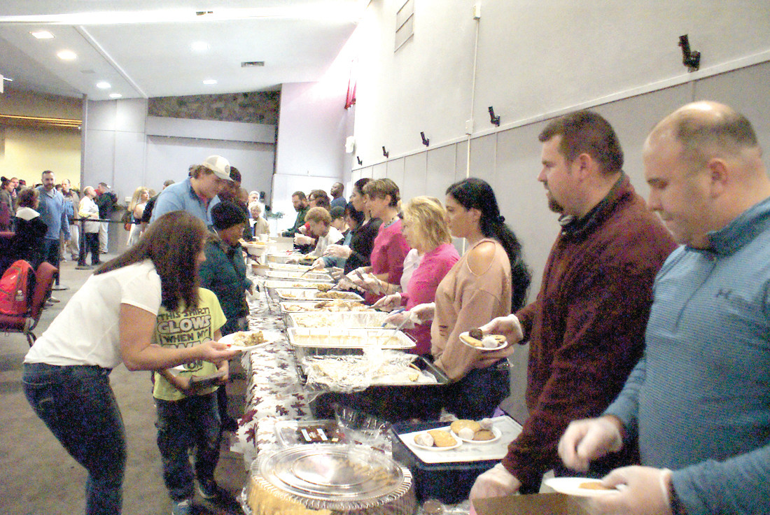 SERVING THOSE IN NEED: Pictured are the many volunteers at Sunday's Thanksgiving Dinner for the Homeless at Praise Tabernacle Church.