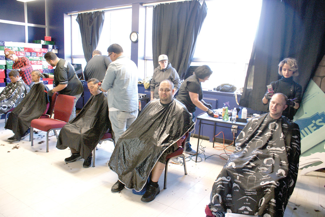 LOOKING GOOD: Many barbers and hair stylists volunteered their time to provide free haircuts to the homeless at the Thanksgiving Dinner for the Homeless this past Sunday. There were more than 50 haircuts done within a few hours.