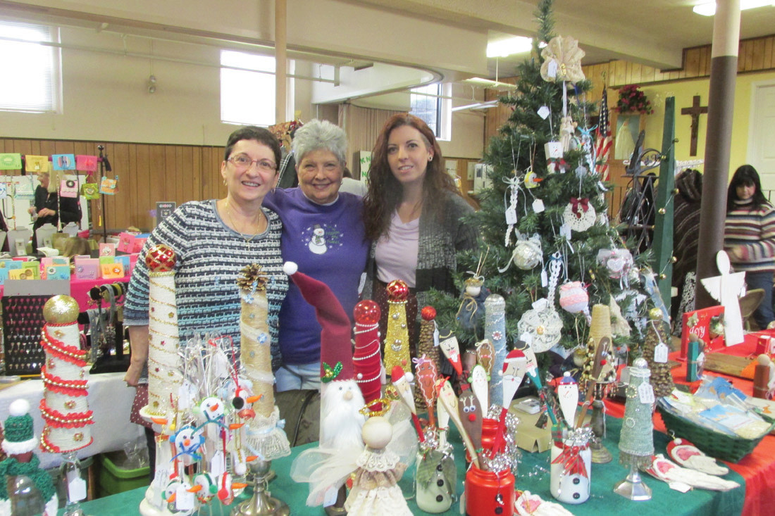 FAIR FUN: Among the many people who visited Saturday's St. Brigid's Church Holiday Bazaar – as well as volunteers – were Melanie Fontaine, Paulette Robertson and Chris Fontaine. (Sun Rise photos by Pete Fontaine)