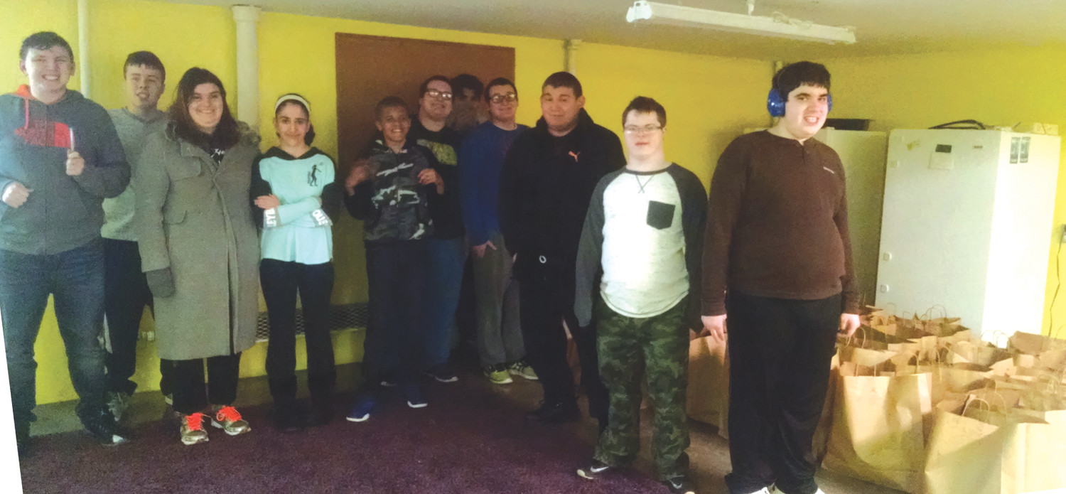 TEAMING UP: Toll Gate special needs students joined the Helping Hands Ministry at St. Peter Church to fill Thanksgiving baskets.