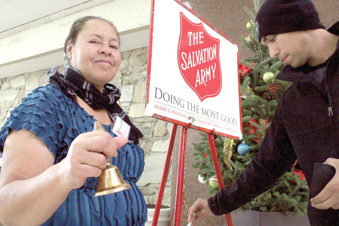 RINGING IN THE DONATIONS: Francisca Giron rings her bell at the Salvation Army kettle at Warwick Mall.
