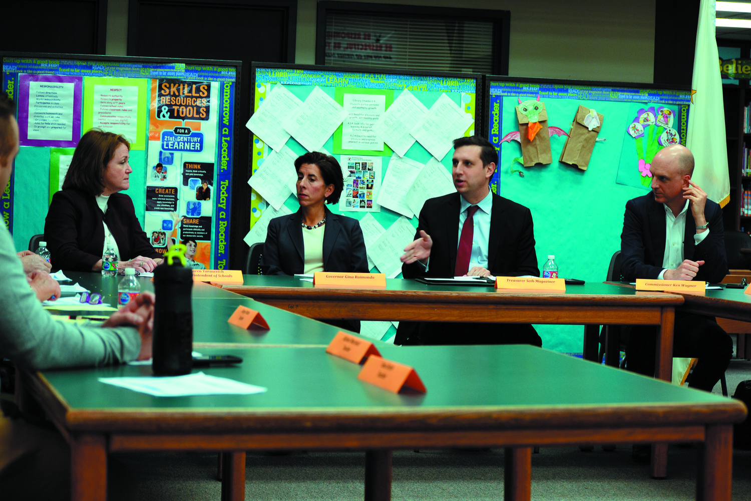 ROUND THE TABLE: From left to right, West Warwick superintendent Karen Tarasevich, Governor Gina Raimondo, state Treasurer Seth Magaziner and Department of Education Commissioner Ken Wagner discuss the state of school buildings in West Warwick at John F. Deering Middle School on Monday, Nov. 27.
