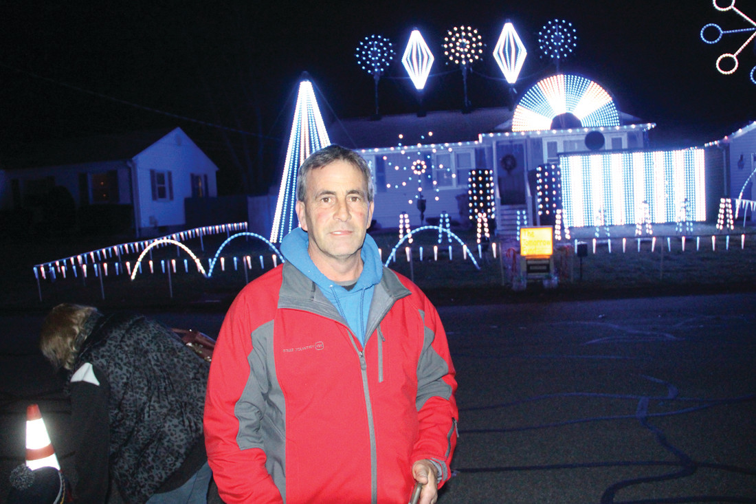 Frank Picozzi in front of his home on Gristmill Road