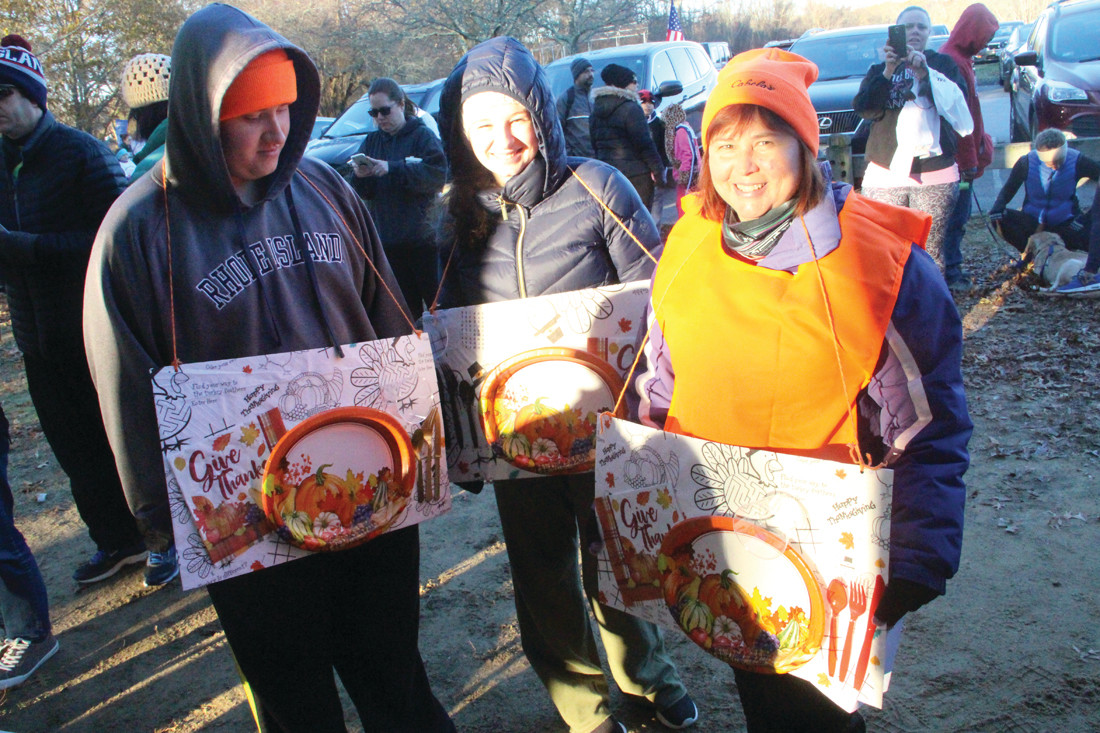 THEIR PLATES WON THEM A DISH: Kathryn, Stephen and Mary Quinn wore plates to the Warwick Rotary Club's annual Turkey Trot on Thanksgiving morning, winning them a gift certificate to a local restaurant.