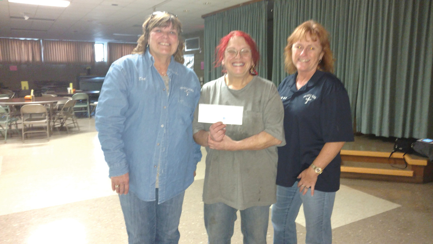 GRAND GIVERS: Adrienne Marchetti (center), Executive Director of the Pawtucket Soup Kitchen, is all smiles after received two checks from Deb Mangina (left) and Lori Eaton at the Tri-City Elks Lodge in Warwick that helped with the non-profits annual Thanksgiving Dinner.
