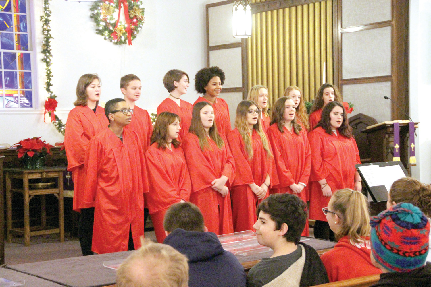 AT THEIR BEST: The Winman Junior High School Chorus sang a variety of Christmas carols at Woodbury Union Church that followed the tree lighting.