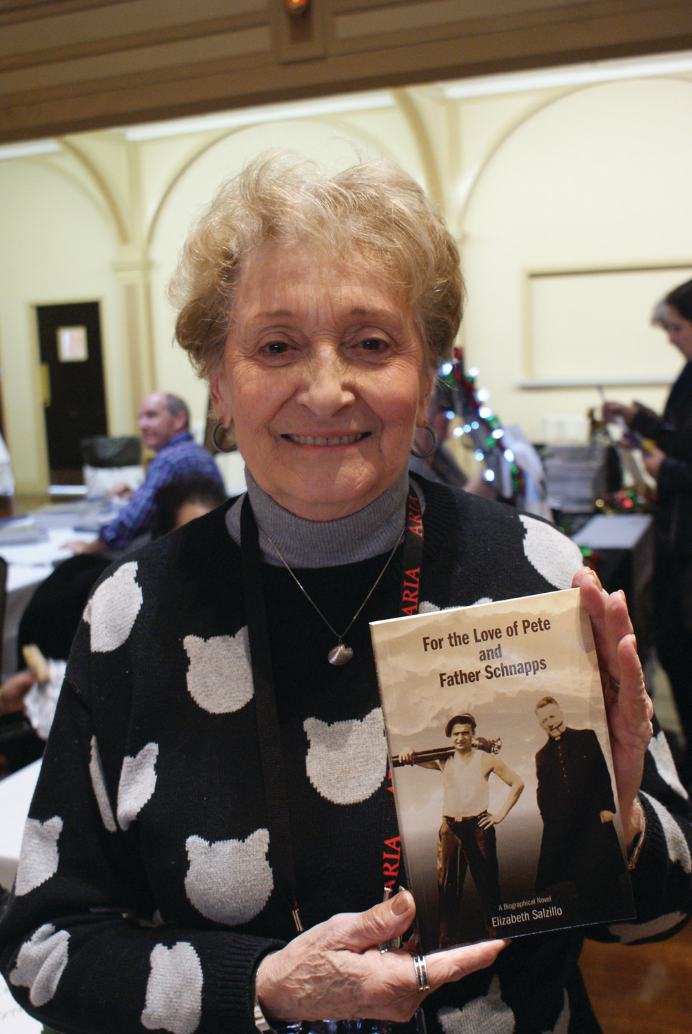 "FOR THE LOVE OF PETE: Pictured is Elizabeth Salzillo of Cranston and the author of ""For The Love Of Pete And Father Schnapps"" which provides details into the life of her father, who was the designer of the Garden City planned community."
