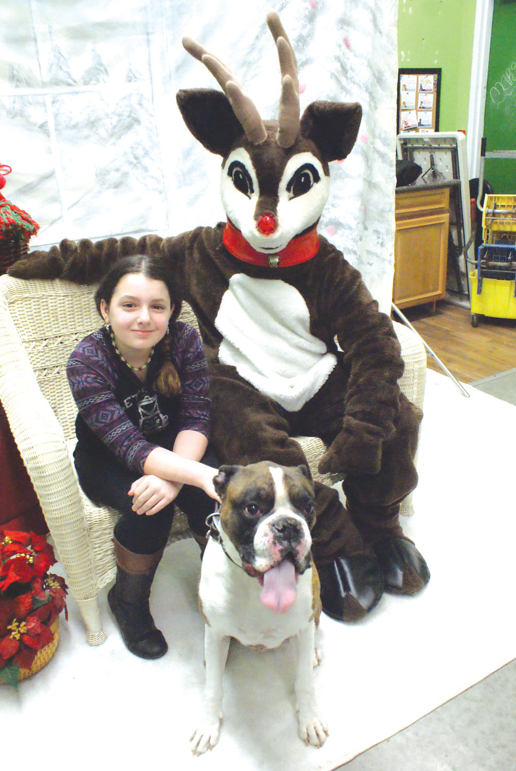THE ONE AND ONLY: Pictured with Rudolph the Red Nosed Reindeer was Italia Antonelli, age 9 with her 6-year-old boxer named Mugsy during the Holiday Photos at Pet Supplies Plus in Garden City to benefit Animals Depend On People Too, Inc. (A.D.O.P.T.).