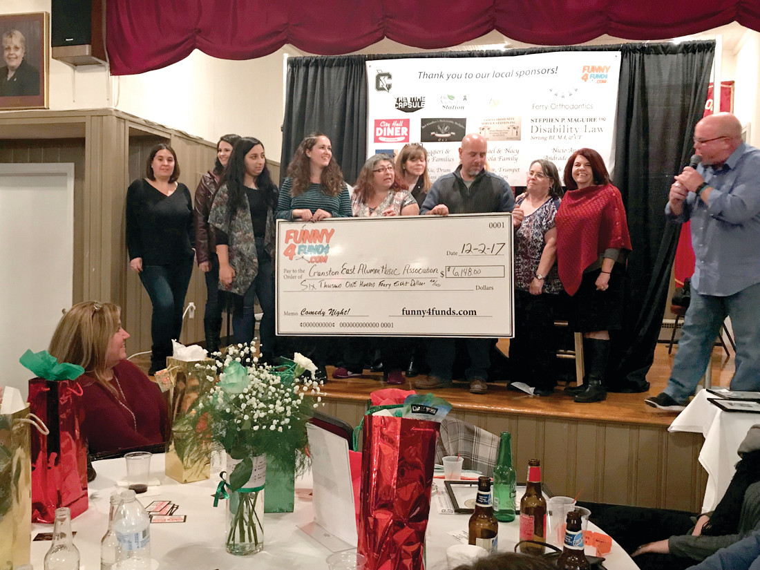THE BIG REVEAL: Members of the event committee show off the big check with the money raised from the Funny4Funds fundraiser on Saturday.