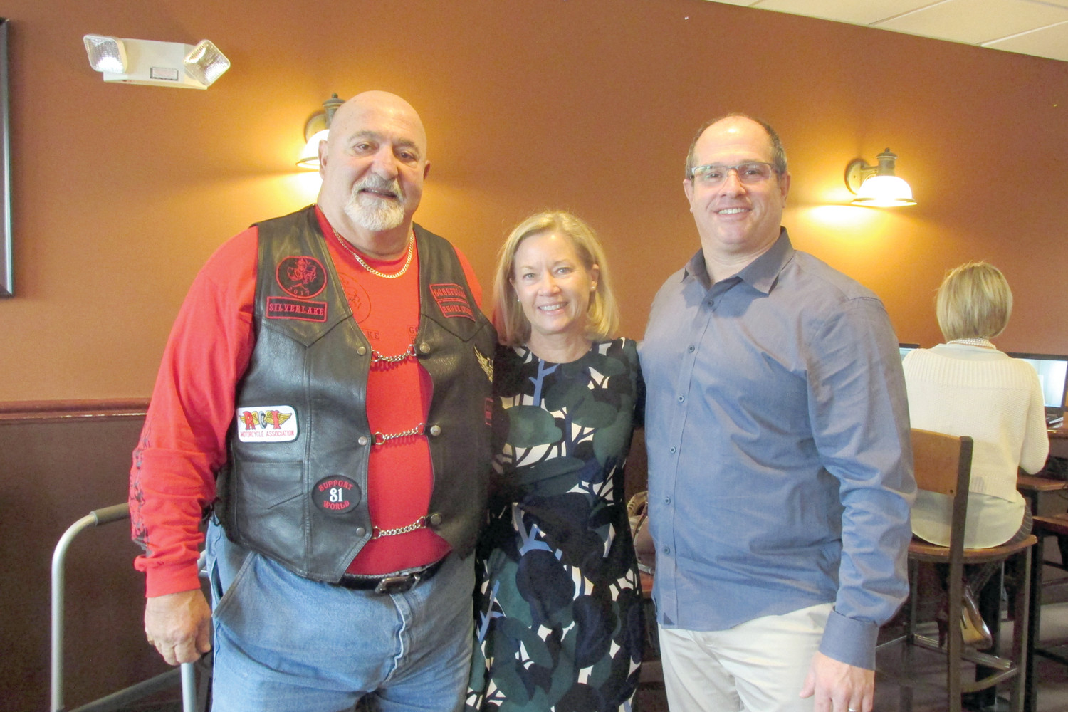"CAL'S CORNER: Anthony ""Cal"" Calabro (left) of the Goodfellas Motorcycle Club is joined by Hasbro Children's Hospital Executive Michele Branigan and David Levesque, owner/operator of Brewed Awakenings in Johnston, during last Thursday's emotion-pitched check presentation in Johnston."