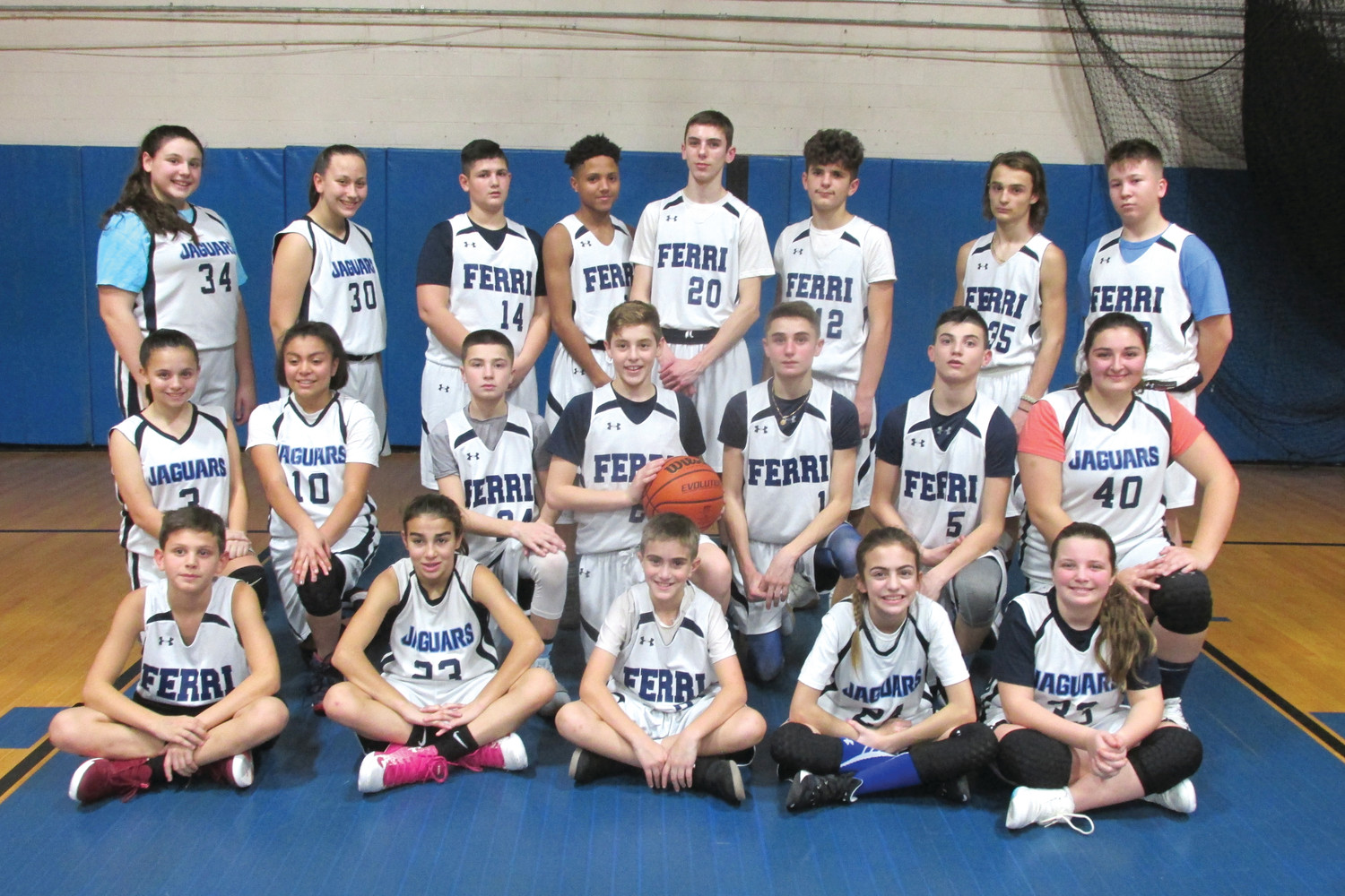 BRIAN'S BUNCH: The White Team was coached by Brian Iafrate in Tuesday's 3rd Annual Toys for Tots Scrimmage inside Nicholas A. Ferri Middle School.