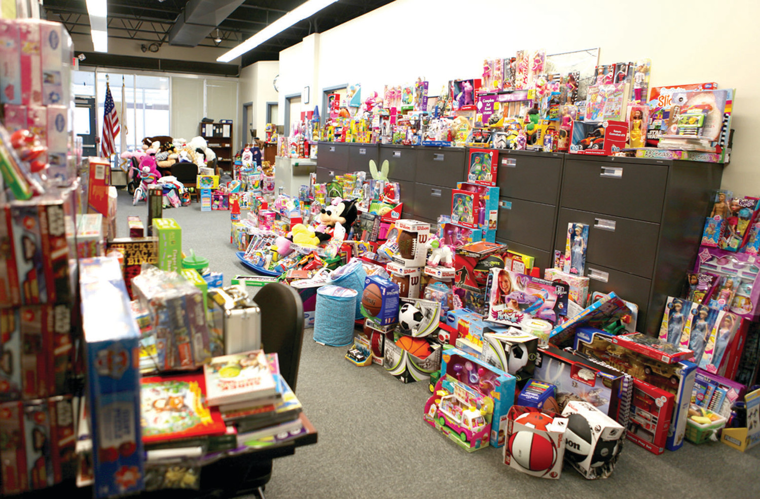 TOY BONANZA: This was the scene at the URI Police Station following the first Stuff-A-Cruiser Toy Drive in 2015.