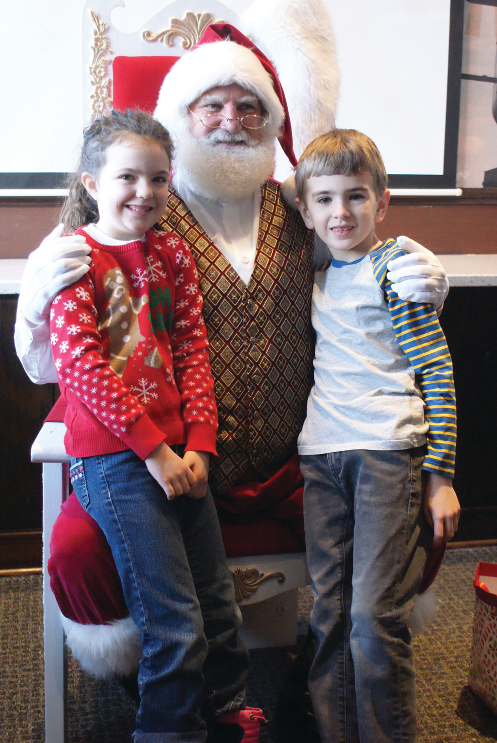 SMILING WITH SANTA: Pictured are cousins Rachael and Carter Pine who are both 7 years old. They enjoyed their breakfast and visit with Santa at The Corner Bakery in Garden City.