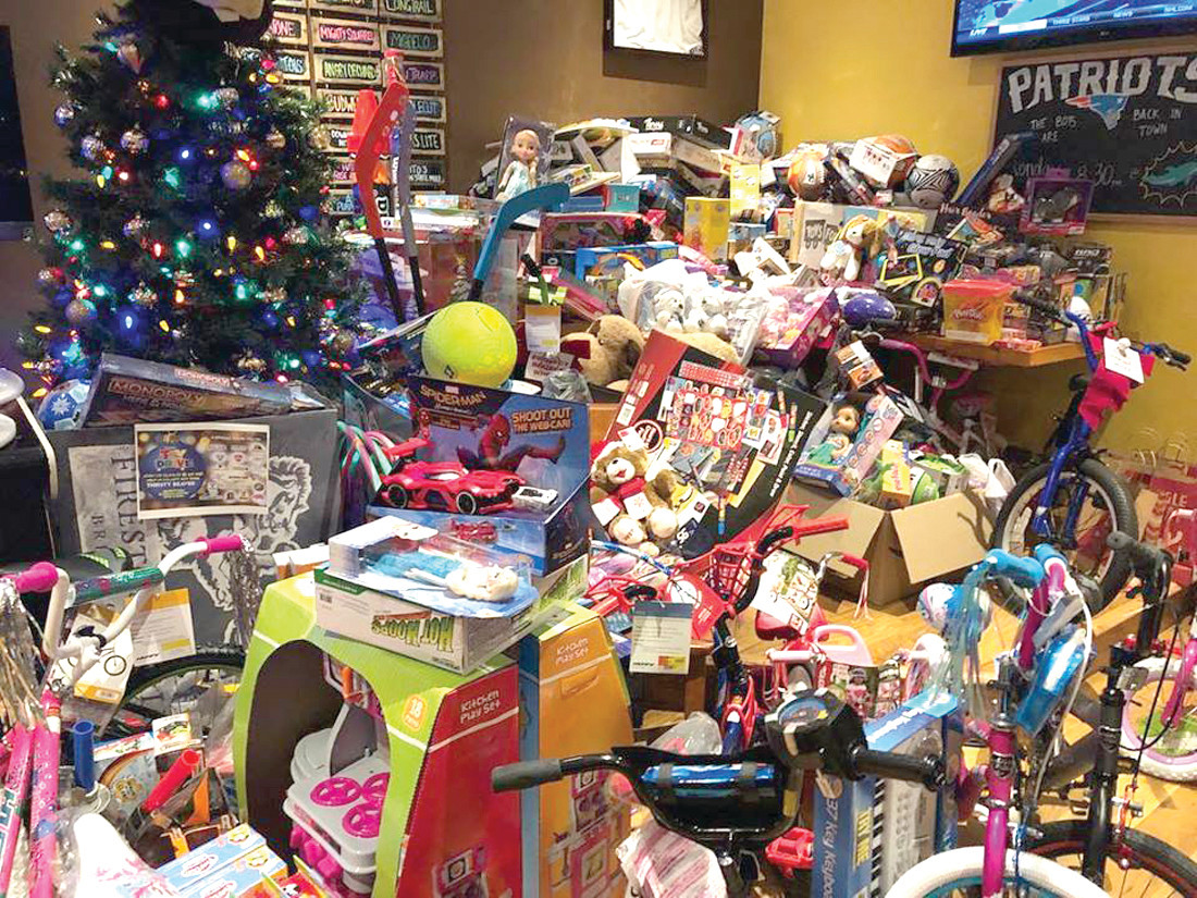 TOYS FOR TOTS: Pictured is the pile of toys at The Thirsty Beaver in Cranston during their 4th Annual Toys for Tots toy drive benefiting Toys for Tots and The Rhode Island Dream Center. The Thirsty Beaver in Smithfield also held a toy drive and together; they collected a total of 5,000 Toys for Tots.