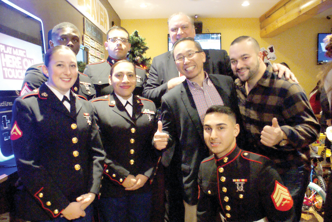 FESTIVE FOR A CAUSE: Mayor Allan Fung participated in the 4th Annual Toys for Tots at The Thirsty Beaver in Cranston and is pictured along with event co-hosts, Ed Brady and Jacob Belt. They are photographed with members of the U.S. Marine Corps who assisted at the event: Cpl. Carlos Gonzalez, Cpl. Marcus Wilson, Sgt. Brian Soares, LCPL Hannah Brown and SSGT Karina Santiago.