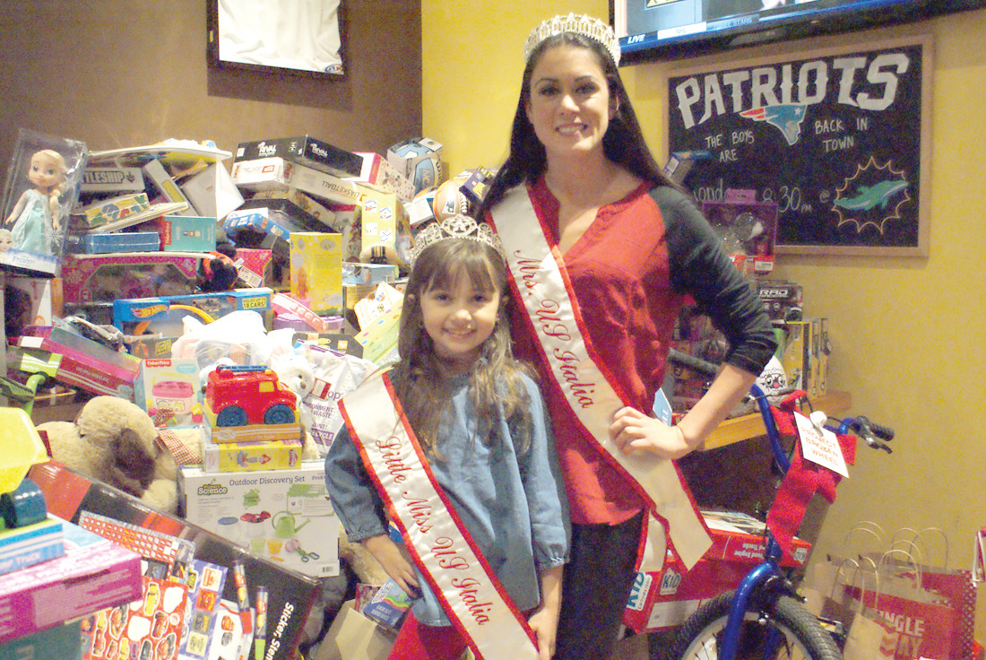 THE BEAUTY OF IT ALL: Both US Italia Nicole Martins and little Miss US Italia Elena Capaldi, age 7 helped during the 4th Annual Toys for Tots at The Thirsty Beaver in Cranston.