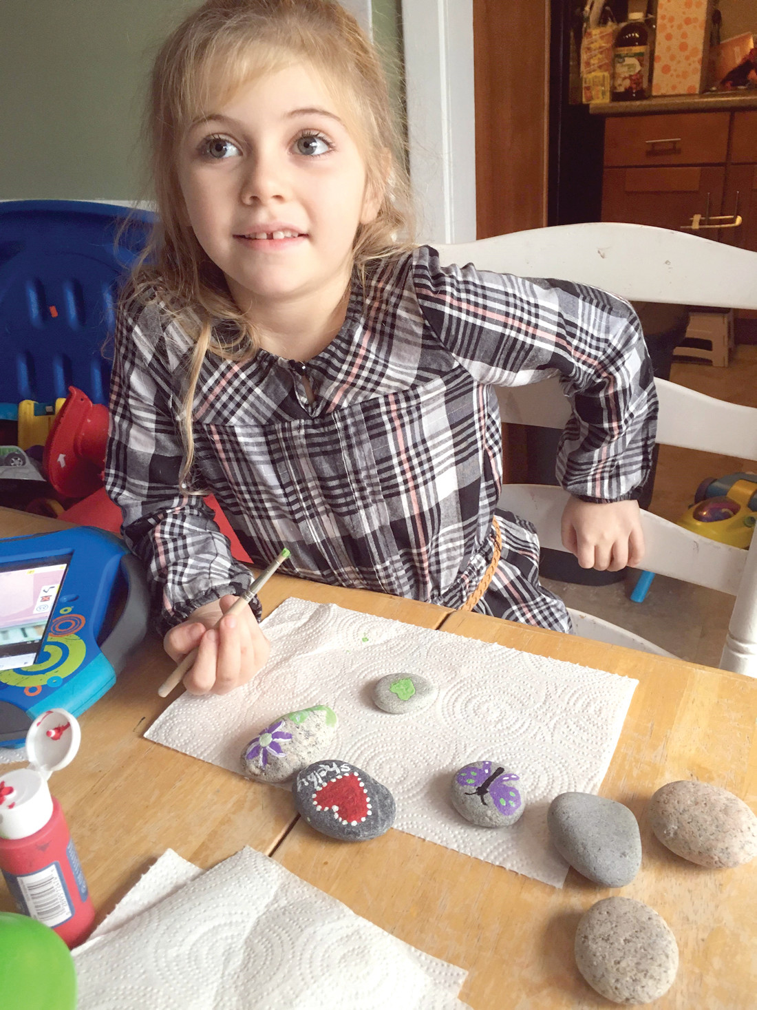 PICTURE PERFECT: Six-year-old Shelby McCarthy paints stones recently picked up from Scarborough Beach, which were later hidden at City Park.