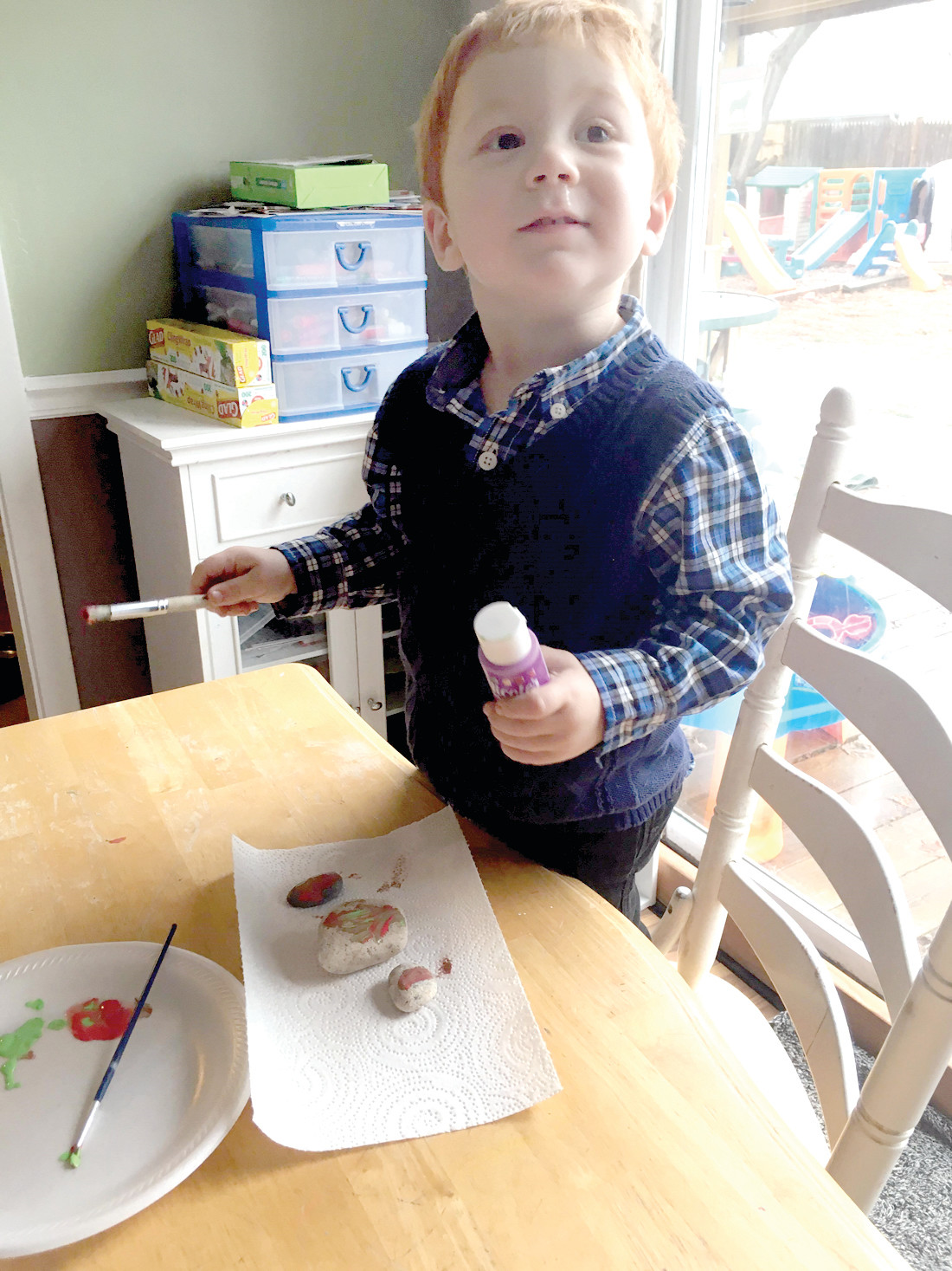 PIECE DE RESISTANCE: Two-year-old Cole McCarthy likes to paint multiple rocks at once at his grandmother's house.