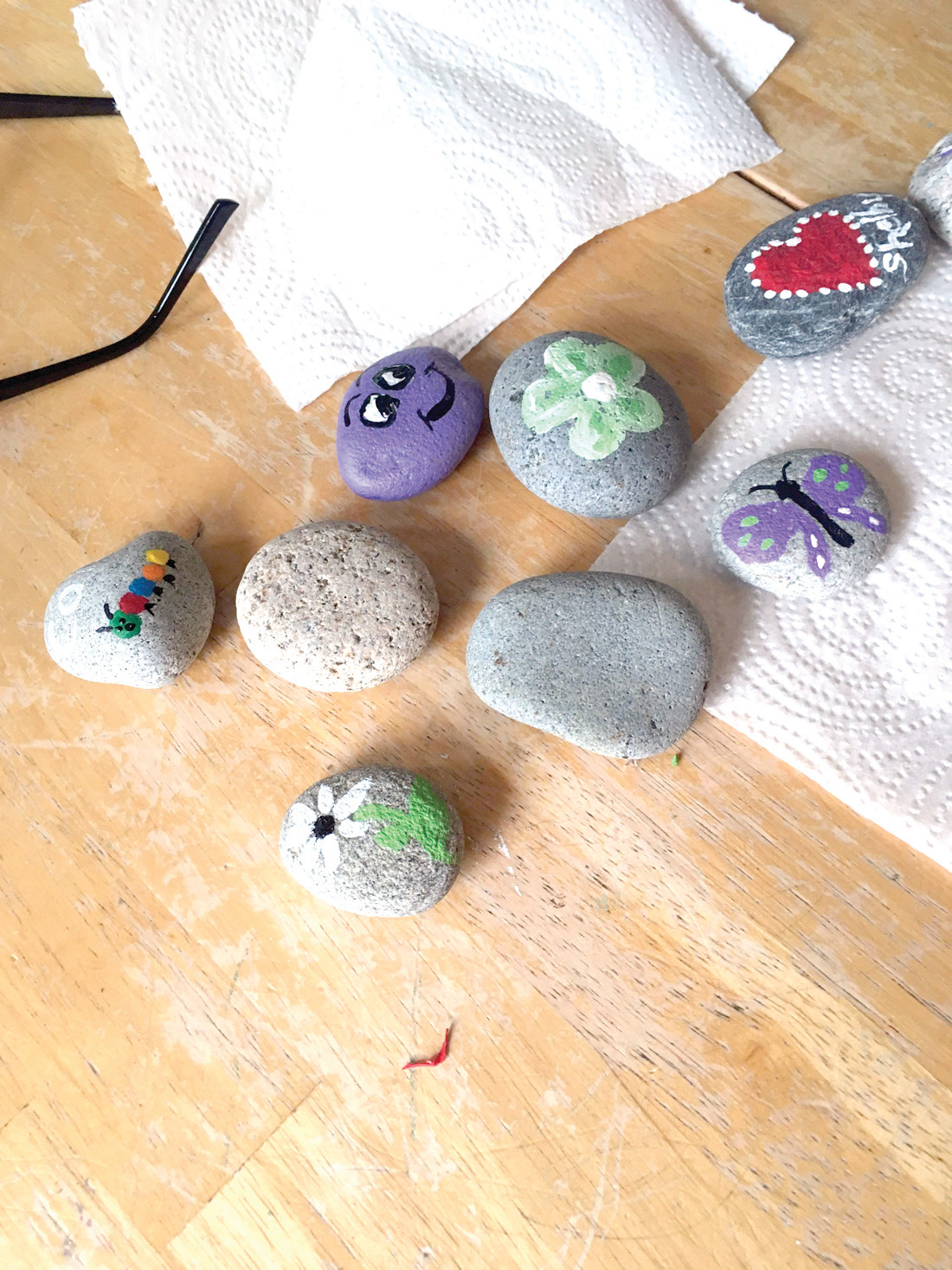 "BUGS AND BUTTERFLIES: Some of the finished rocks painted by Shelby and Cole McCarthy. There's no limit to the designs that may be placed on a stone, ""rockers"" are encouraged to be creative."