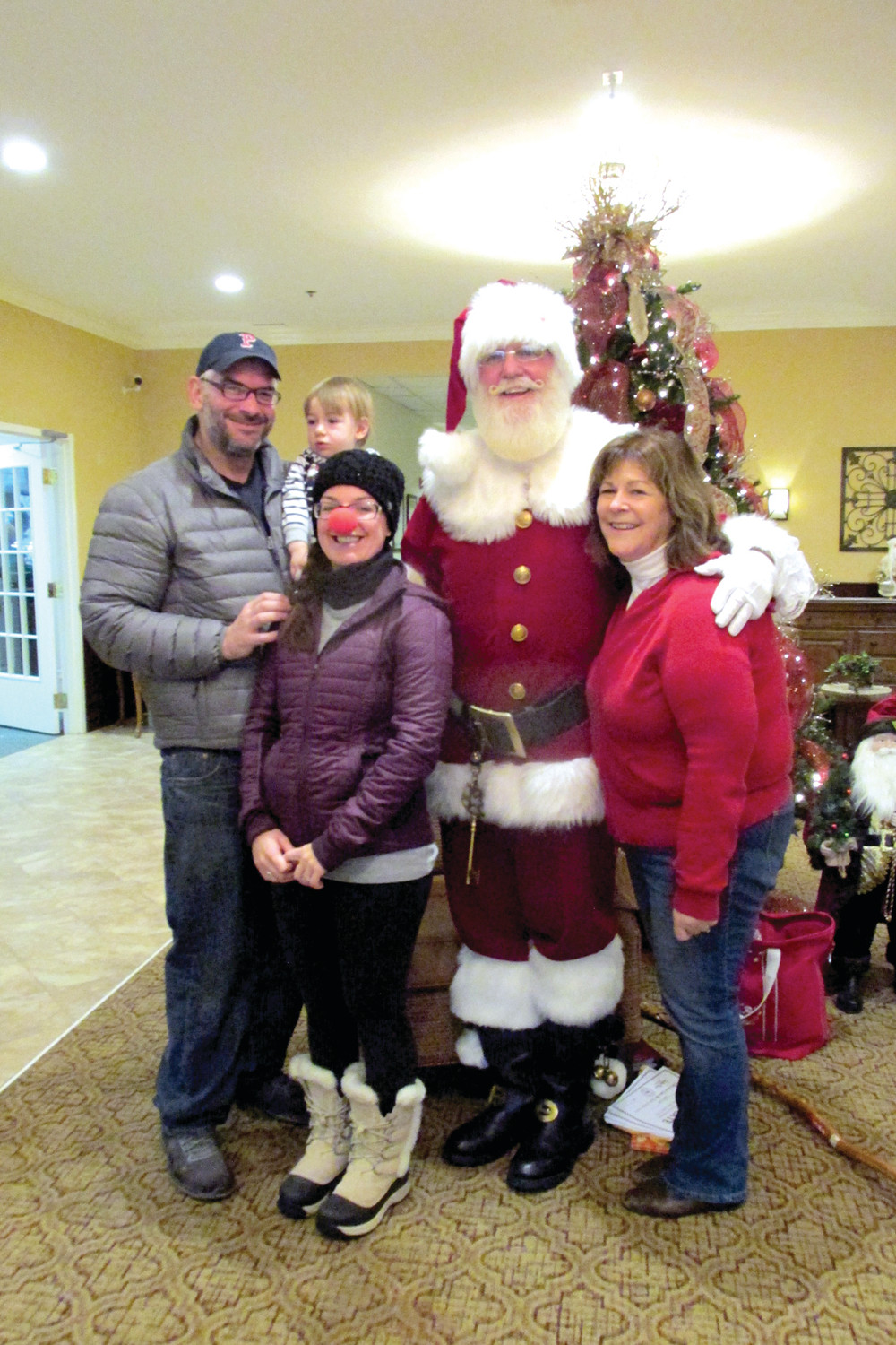 "MIGHTY MEMORY: Santa ""Paul Evens"" Claus made Saturday special for the Grace family – Jameson, Robert, Kerri and Maryann – during Saturday's family-oriented Open House at The Bridge at Cherry Hill."
