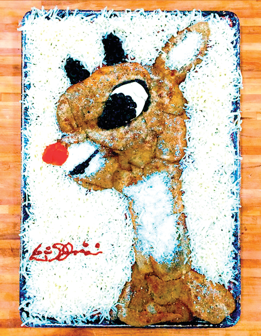 RUDOLPH THE RED NOSE REINDEER:  While Rudolph's nose may be red, the brown in this pizza was created with eggplant that was breaded. Each pizza that Eric creates is personally signed by him.