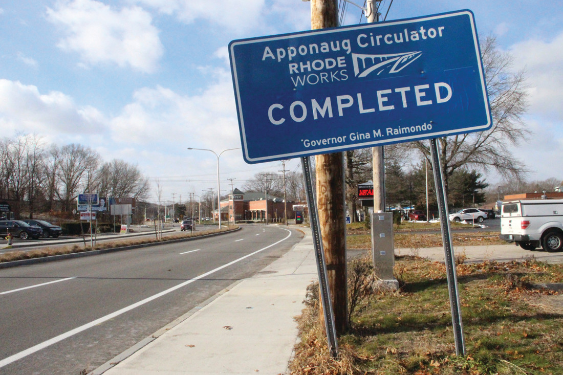 NOT DONE YET: While the off-kilter sign proclaims the Apponaug circulator is completed, the state will be revising signage in the months to come.