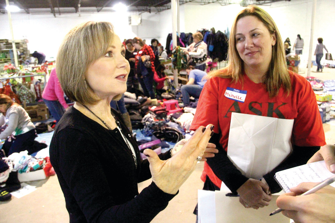 COORDINATORS: Bobbie Bacon and Michelle Jordan oversee operations where volunteers coordinate the gifting of about 40,000 gifts as part of the Gregg's Giving Tree program.