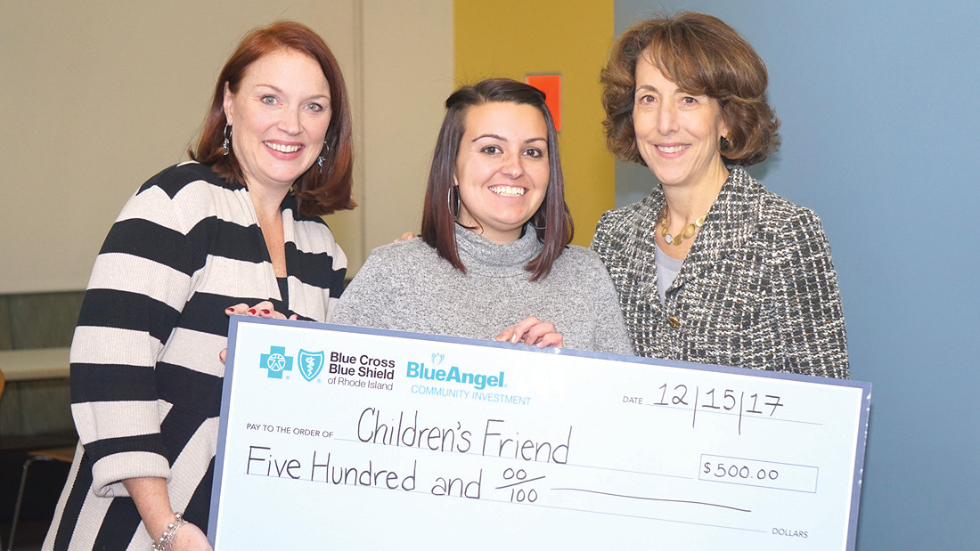 ANGEL OF THE YEAR: Stephanie Vito, winner of Blue Cross' BlueAngel of the year, receives her $500 check from (left) Carolyn Belisle, managing director of community relations at Blue Cross RI and (right) Kim Keck, president and CEO of Blue Cross RI.
