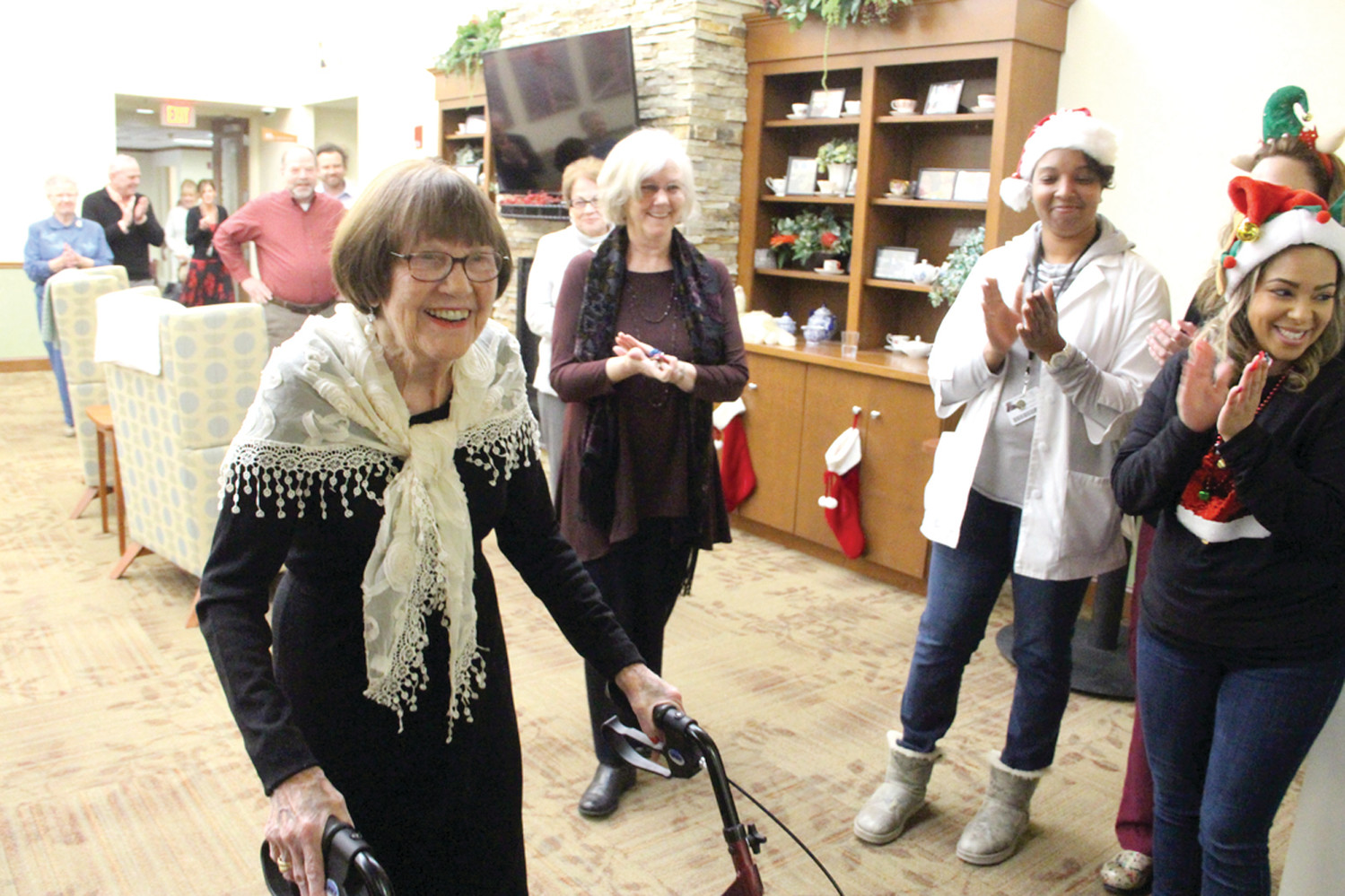 READY FOR A PARTY: Ester Sarafian makes a grand entrance to the applause of Scandinavian Home staff and family members at Fridays party celebrating her 100th birthday.