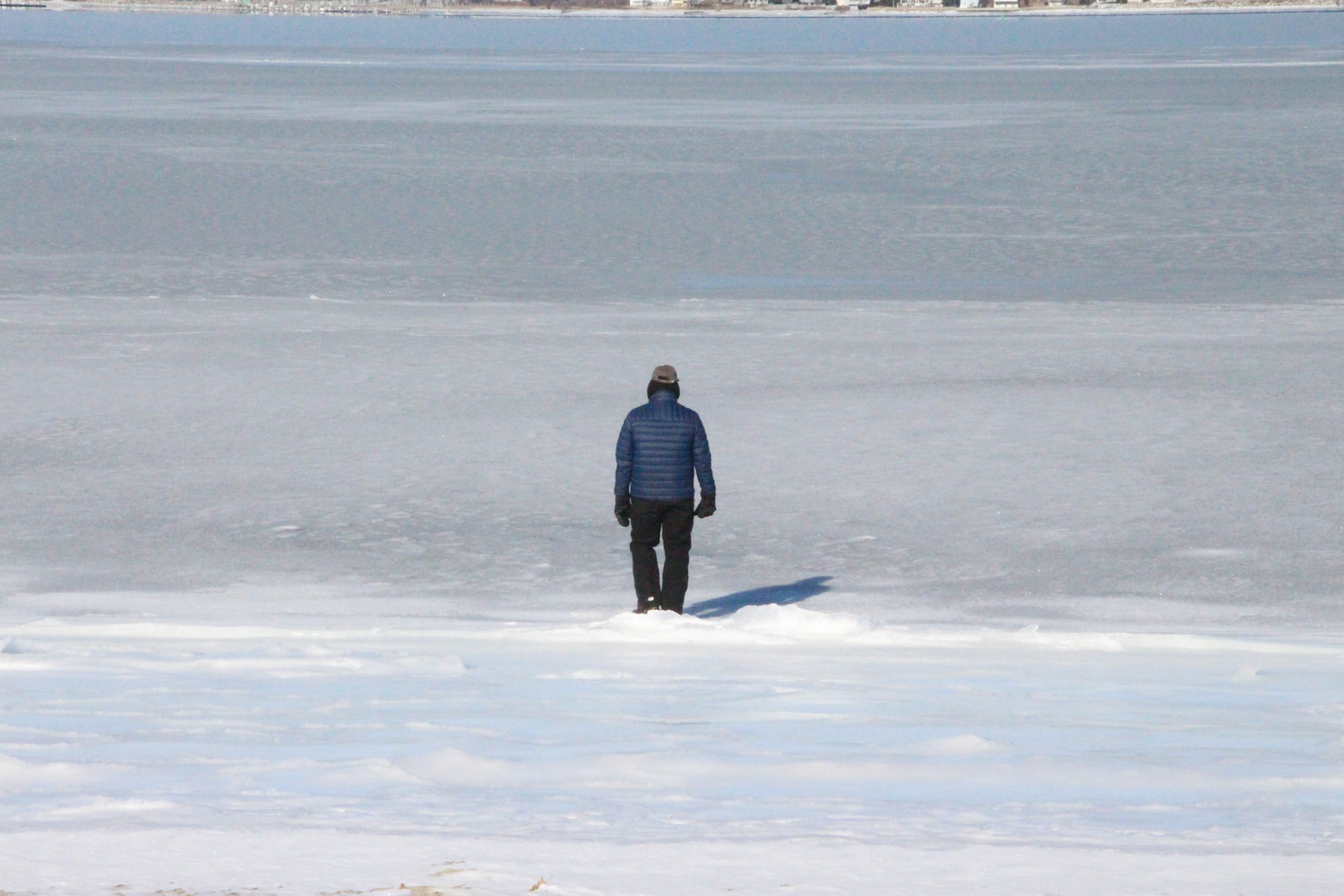 SKATES MIGHT HAVE WORKED: One of those who turned out for the 7th annual Frozen Clam Dip and Obstaplunge surveys a frozen Greenwich Bay. While a hole had been cut in the ice, the DEM forbade anyone from taking a dip.