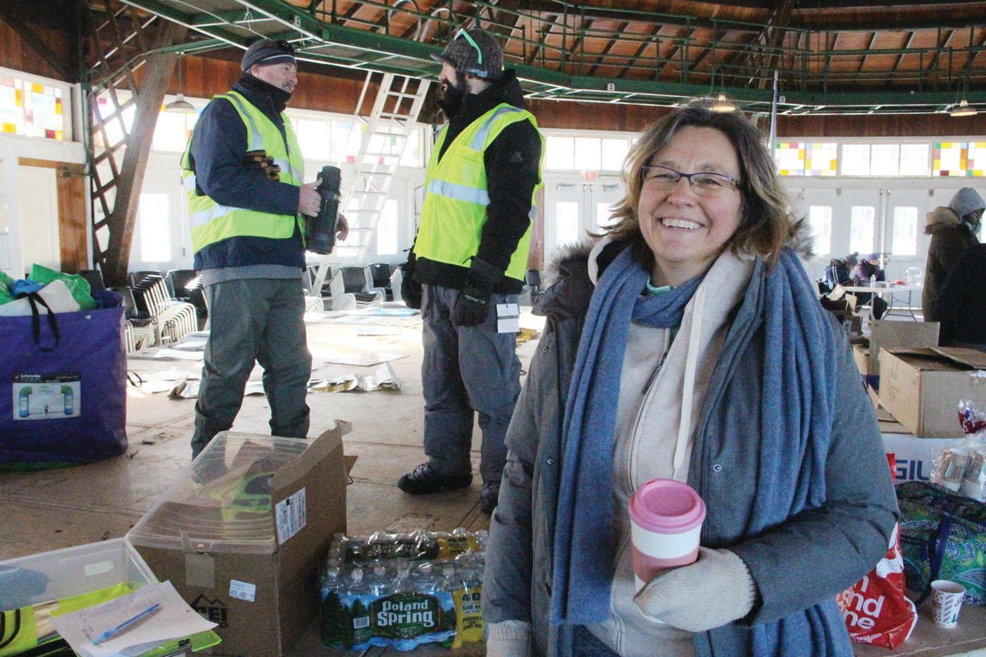 ALWAYS THE OPTIMIST: Jo-Ann Schofield, president and CEO of Mentor Rhode Island, gave a warm New Year's welcome to those braving the freeze. She's hopeful for warmed conditions on Jan. 28 that has tentatively been scheduled for the Frozen Clam Dip.