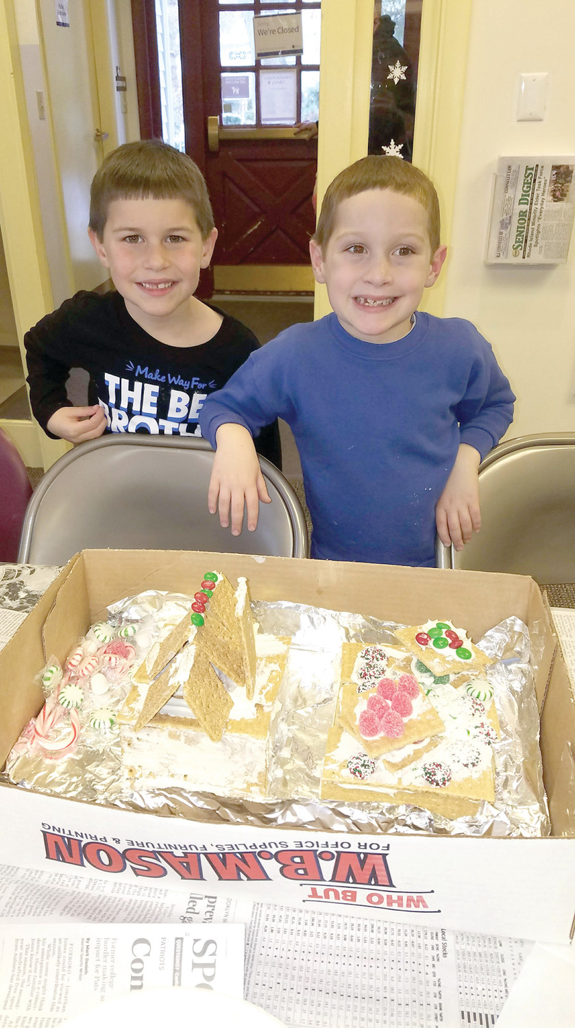 GINGERBREAD BOYS TO MEN: Massimo and Luca DePalo from Oaklawn Elementary school first graders, proudly show off their final creations.