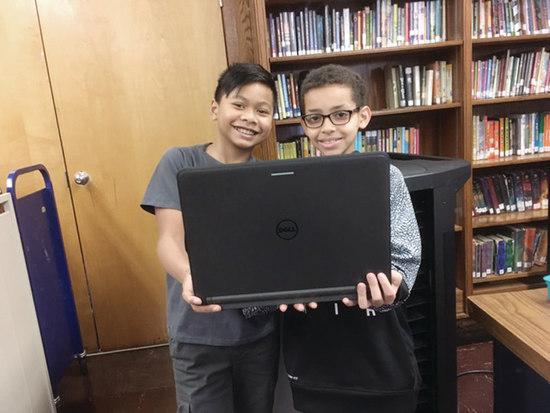DELL-VING INTO CODE: Gladstone 4th graders are all smiles after their Minecraft coding victory.