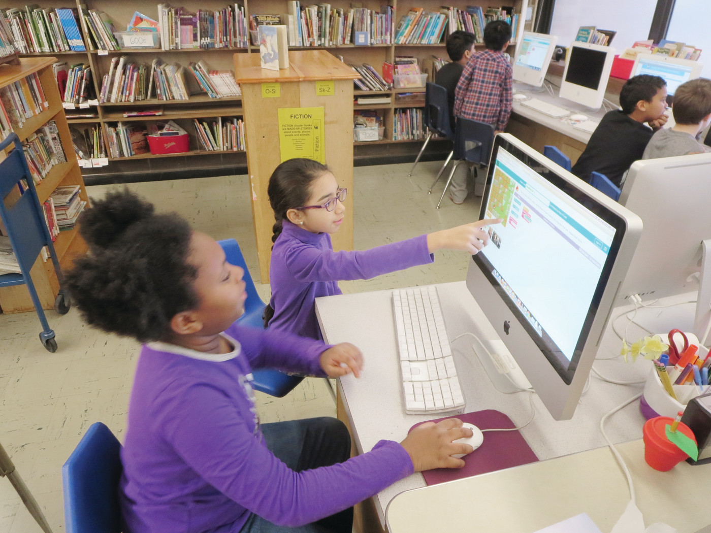 APPLE-YING WHAT THEY LEARNED: Stadium Elementary students worked together to finish coding tutorials and solve Minecraft challenges.