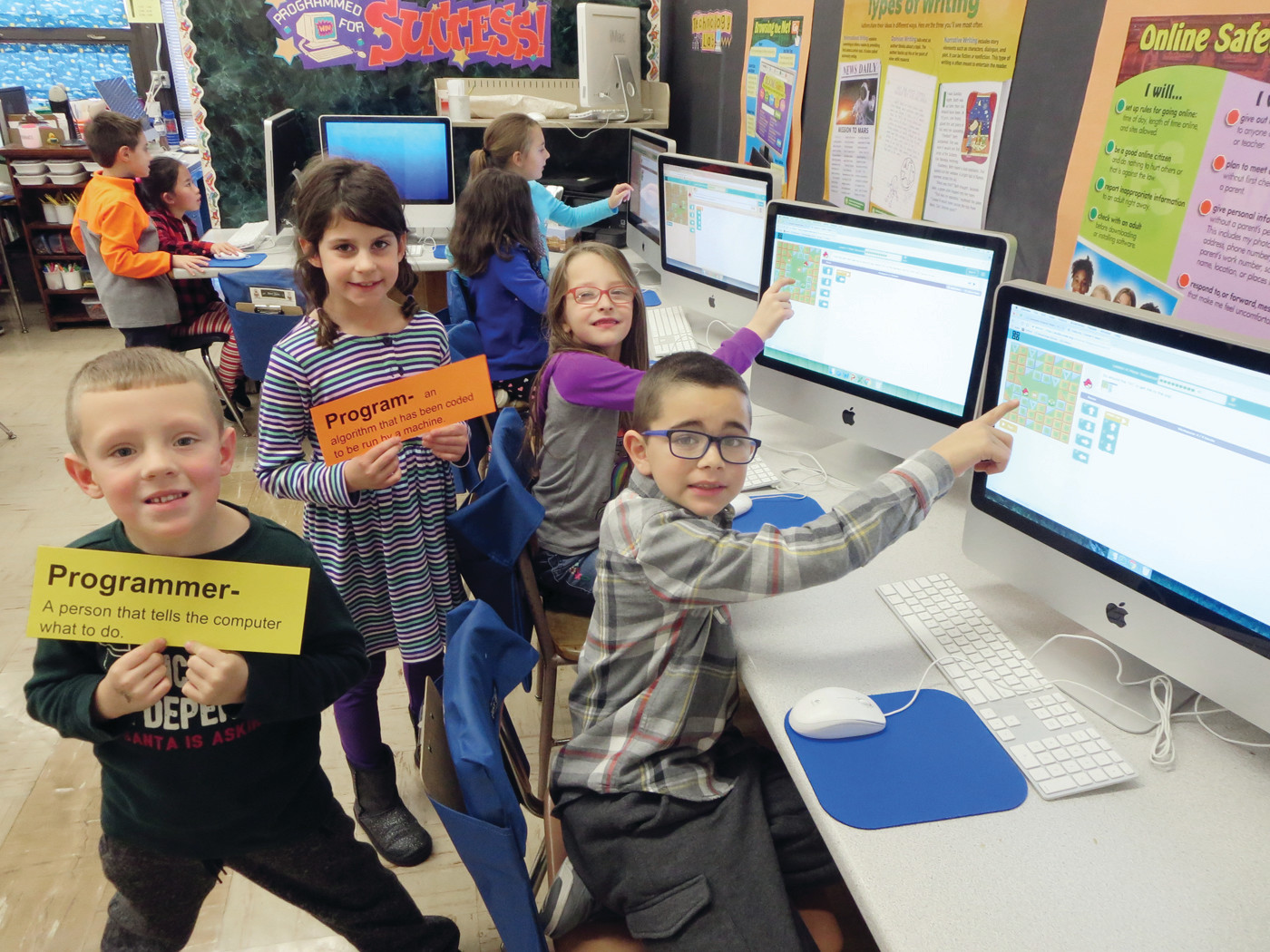 CERTIFIED PROGRAMMERS: Woodridge Elementary students apply what they've learned about computer science terminology to their coding games.