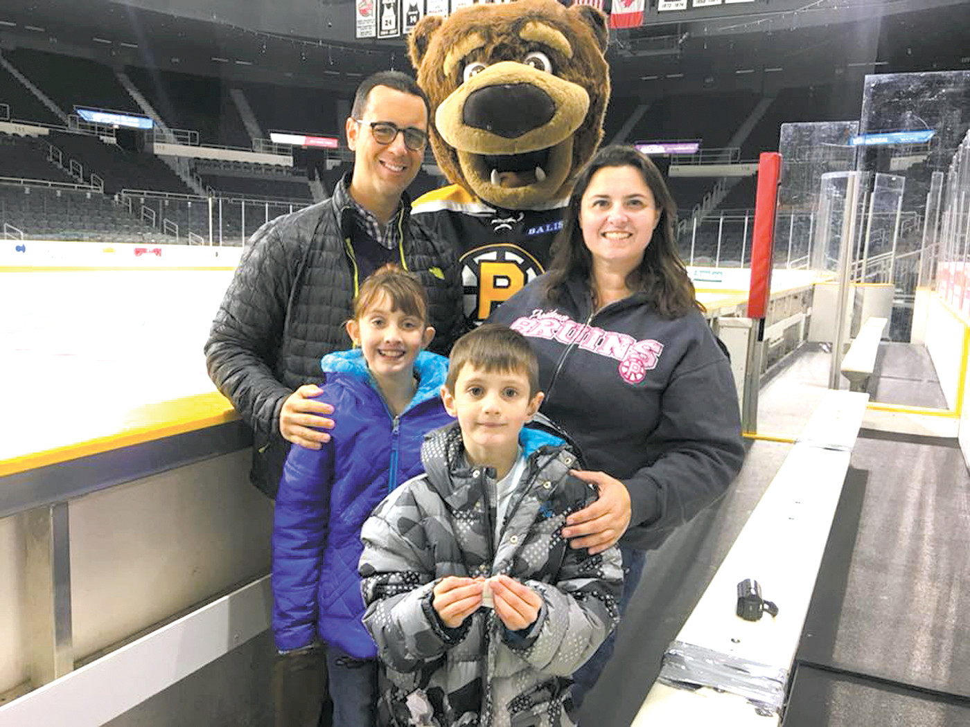 THE 'FUN' IN FUNDRAISING: Rich Pezzillo, executive director of the New England Hemophilia Association and Samboni, the P-Bruins mascot, with Madeline Murray, T.J. Murray and their mother Meagan Murray prior to the game which raises funds for the Tomorrow Fund at Hasbro Hospital.