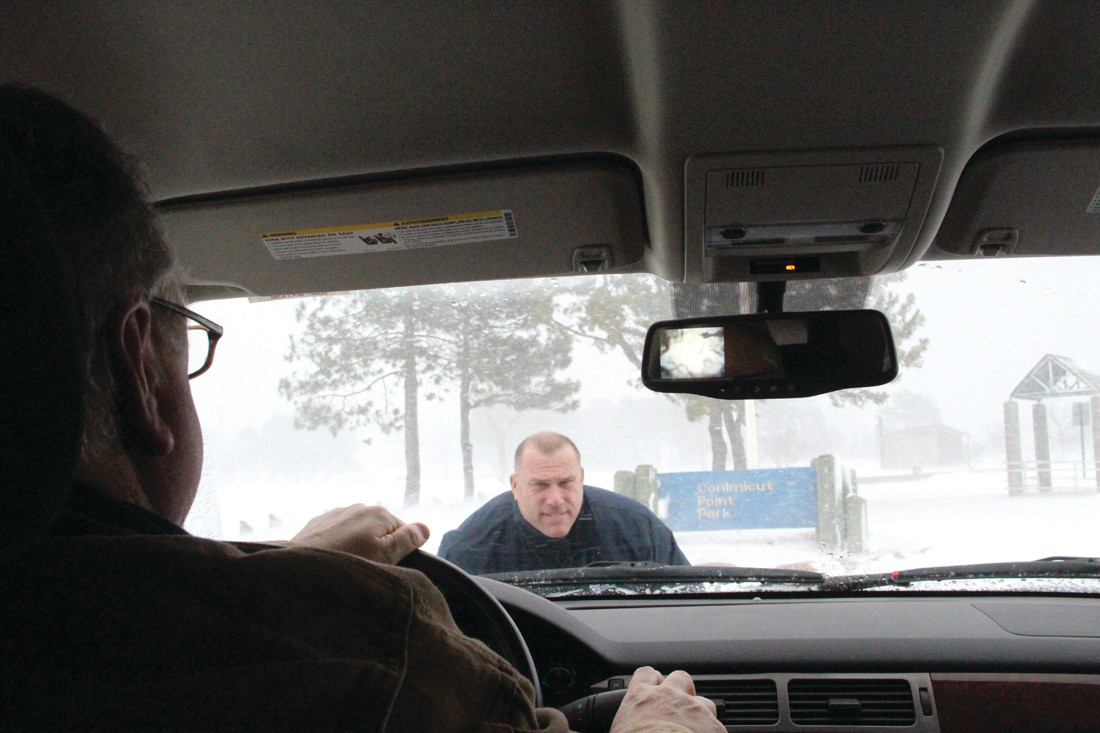 TO NO AVAIL: Chief of staff Ray Studley lends his weight to the Chevy Tahoe driven by DPW Director Richard Crenca that became snowbound. A city plow cleared a path for the vehicle.