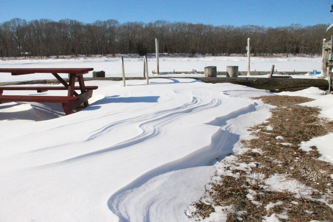 WAVES OF SNOW: Snow laps at the picnic benches at the Little Rhody Yacht Club in Oakland Beach.