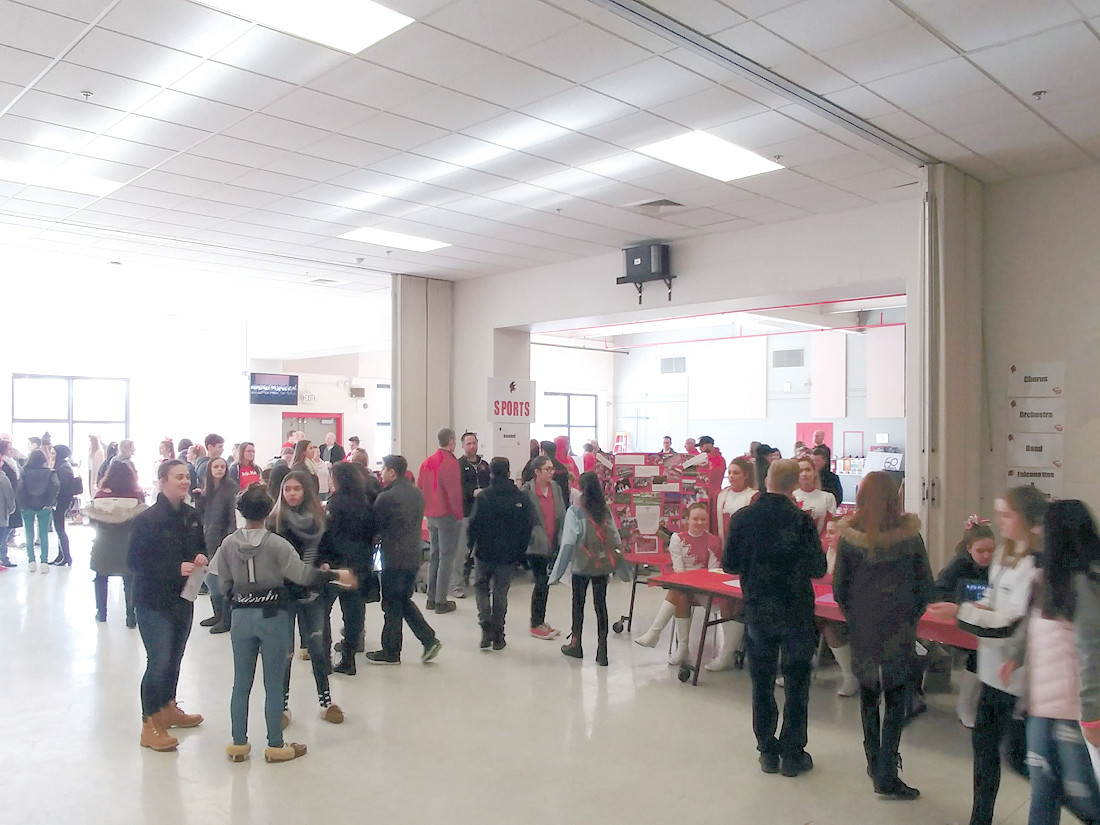 SO MUCH TO OFFER: All who attended the open house were invited to circulate through the dining room which housed tables of staff and students representing all academics, extra-curricular activities, sports and clubs. Students and parents could ask questions, sign up for more information, view materials and digital presentations.