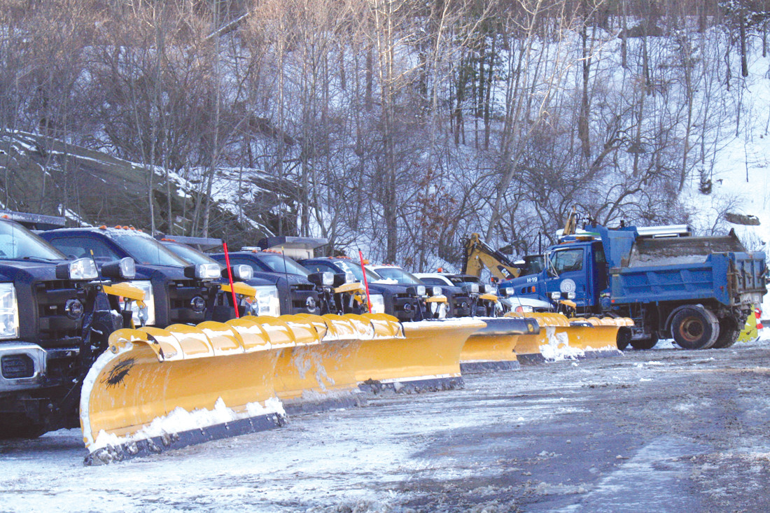 GANG'S ALL HERE: Pictured Friday, the snow removal trucks line the parking lot of the Department of Public Works Phenix Avenue location.