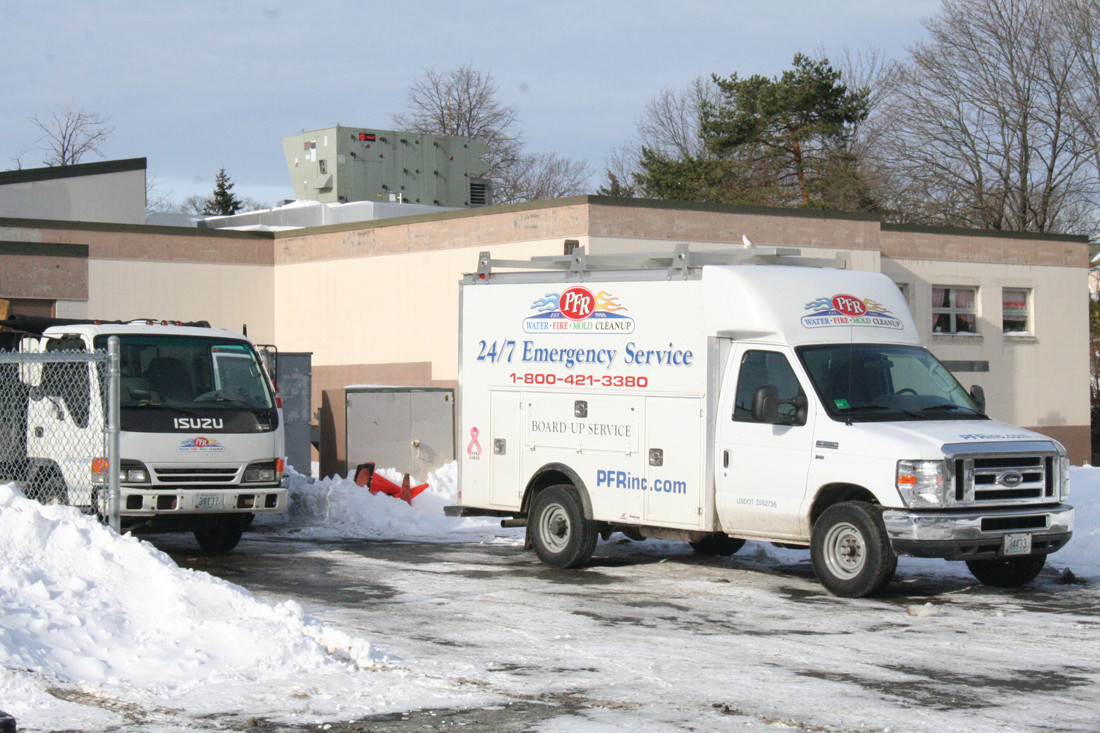CLEAN UP, CLEAN UP, EVERYBODY, EVERYWHERE: Cleaning companies were seen outside of both Edgewood Highland and Cranston East on Monday dealing with the flooding.