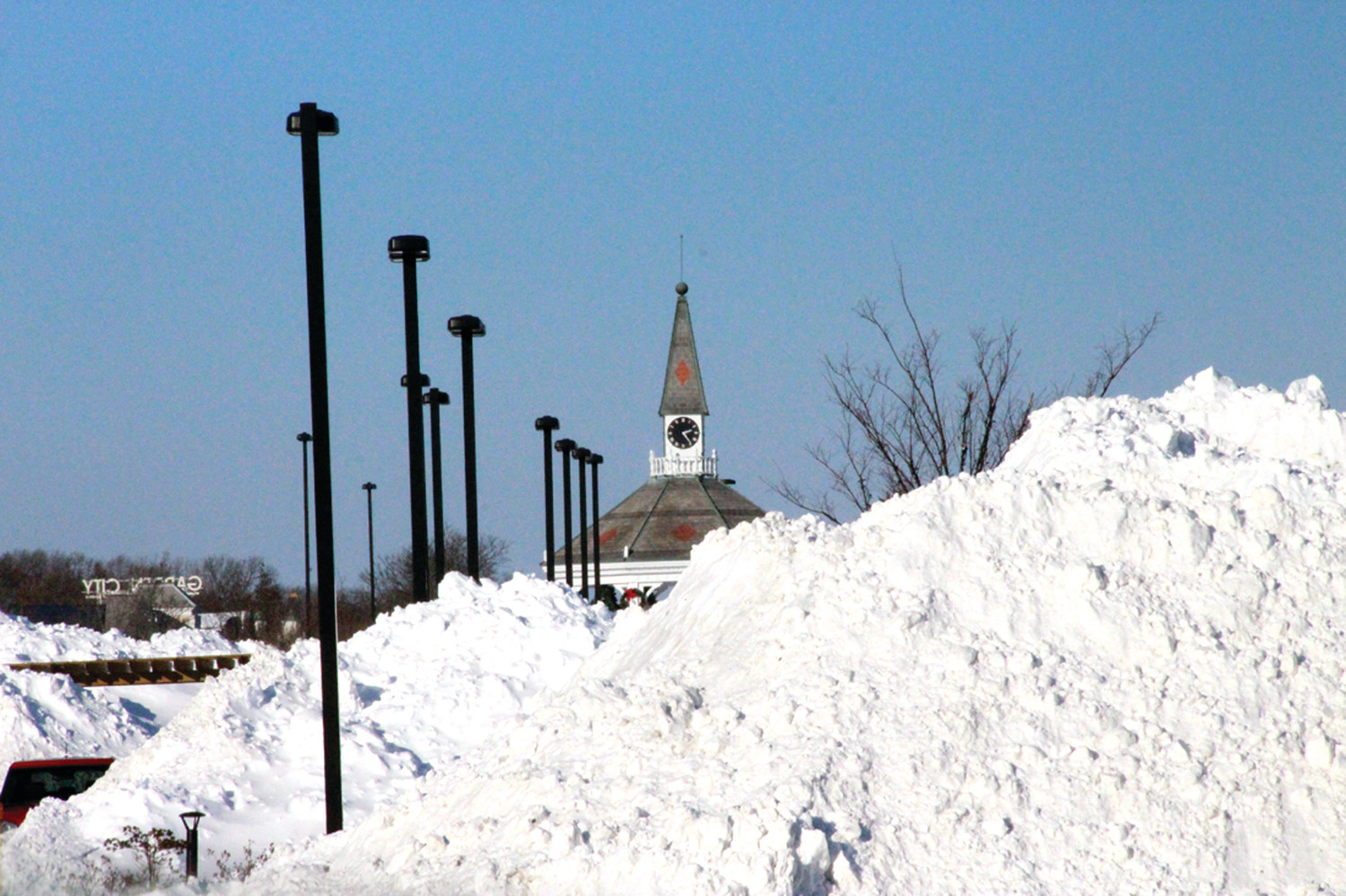 PEERING OVER THE PEAK: Snow piled up as high as the gazebo in Garden City on Friday afternoon.