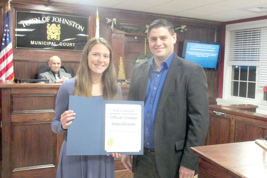 AWESOME AWARD: Sydney DeCesare holds the citation District I Councilman Richard J. DelFino III presented to the Salve Regina University freshman for being named the Newport-based school's Cross Country Rookie of the Year.