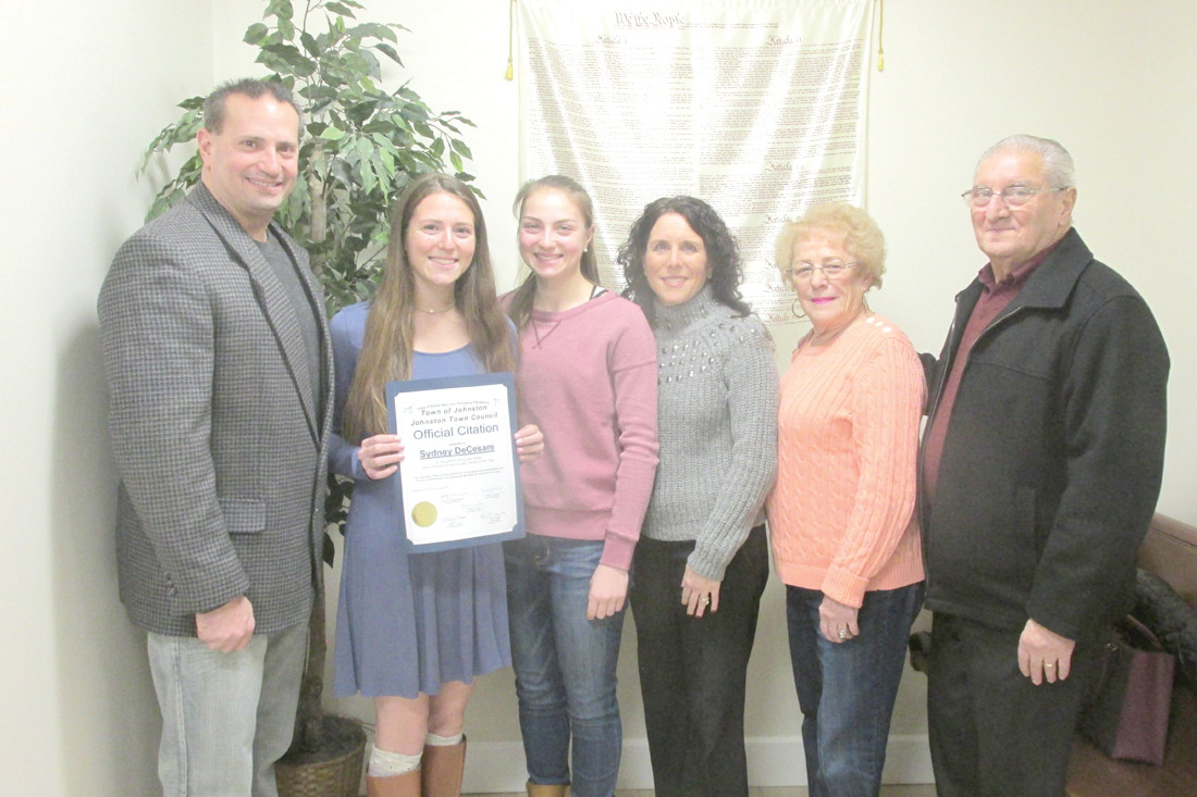SPECIAL SUPPORTERS: Sydney DeCesare (second left) is joined by her father David DeCesare, sister Jayme, mother Jo-Ann, grandmother and grandfather Annette and John Rainone, after being honored at Monday night's Johnston Town Council meeting.